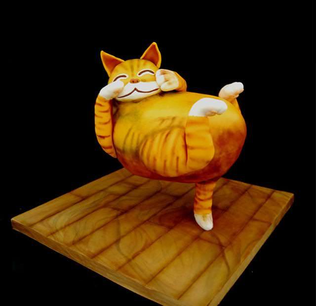 コンクールの優秀デザイン:尻尾だけで全身を支えて宙に浮かんでいるネコのケーキ
