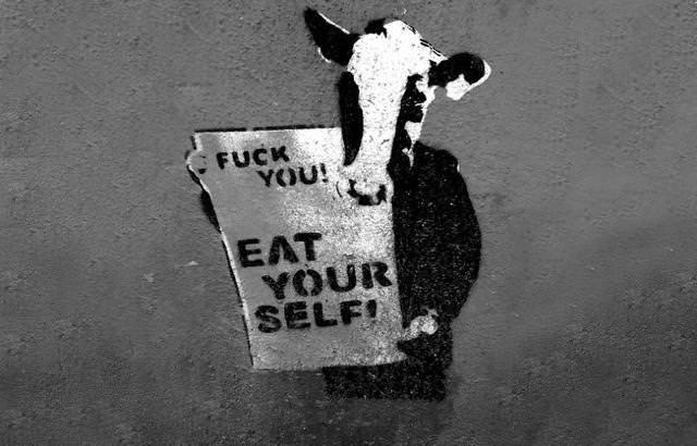 環境問題の風刺画:共食いで狂牛病を発症